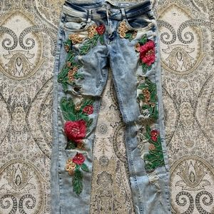 Jeans with flower designs and crystals